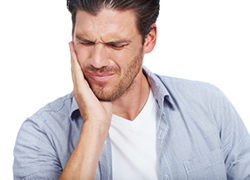 Man experiencing jaw pain