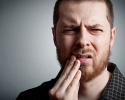 The History and Hidden Dangers of Dental Abscesses