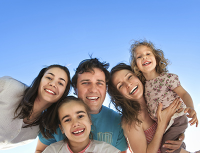 Moorestown, NJ family smiling about their dentist visit.